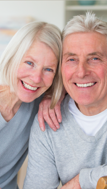 An elderly couple happy with their new dentures.